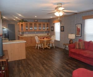 Living room with the kitchen area from the house model 1676A from Pratt Homes offer