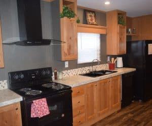 Wooden kitchen detail from the house model 1676A from Pratt Homes from Tyler Texas
