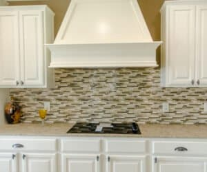 Kitchen with stove from Pratt Homes