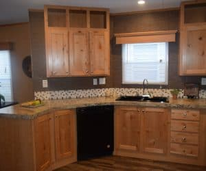 Furnished kitchen from the house model 1676C from Pratt Homes offer