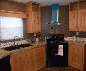 Wooden kitchen details from the house model 1676C from Pratt Homes offer