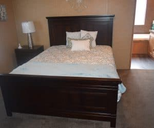Furnished bedroom from the house model 1676C from Pratt Homes offer