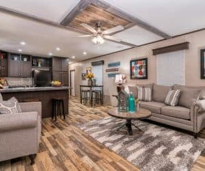 Living room wiht the kitchen of the house model 1676G from Pratt Homes offer