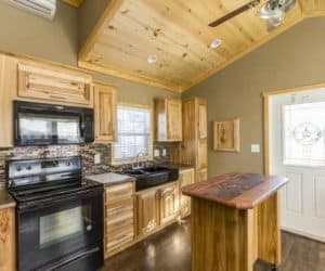 Kitchen area from incredible tiny home model Athens Park 522L made by Pratt from Tyler Texas