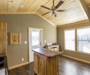 Entrance with kitchen from incredible tiny home model Athens Park 522L made by Pratt from Tyler Texas