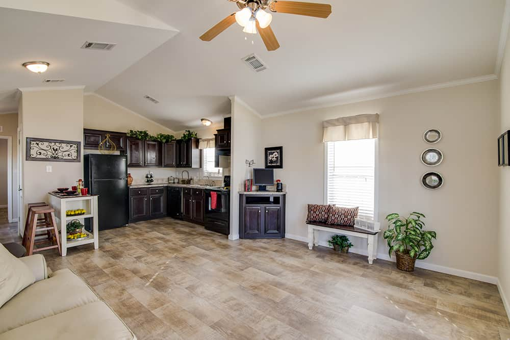 Living room with kitchen of house model CC1207