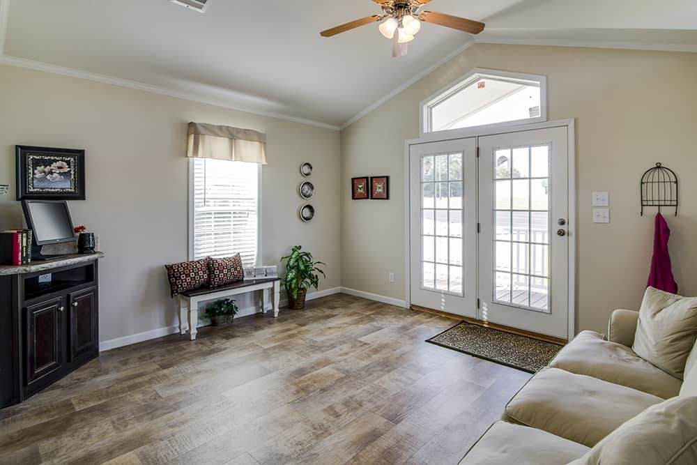 Spacious living room of house model CC1207 made by Pratt from Tyler Texas