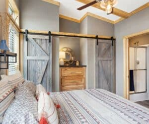 Bedroom of incredible tiny home model Mindy Barnhouse made by Pratt