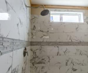 Shower in the bathroom at Pratt Homes Model Lodge 3