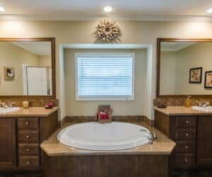 Spacious, furnished bathroom with wooden details