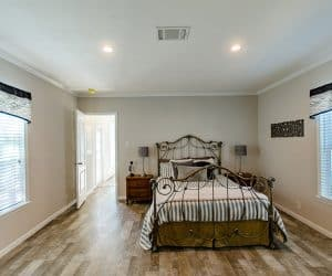 Master Bedroom large bad from home model Estes