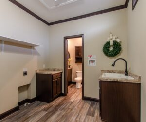 Laundry room in the house model Eastwood made by Pratt Homes from Tyler