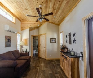 living room in the incredible tiny home Rustic