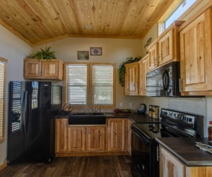 Kitchen in the incredible tiny home Rustic