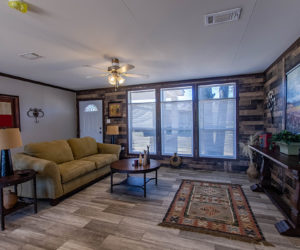 furnished liing room of the house model leo made by pratt homes tyler texas
