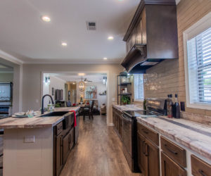 kitchen and dining room at the bailey house made by pratt homes tyler tx