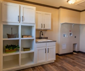 laundry room in house model double offset made by pratt homes tyler texas