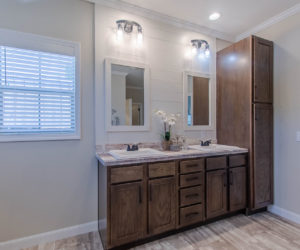 master bath with mirrors at the bailey house made by pratt homes tyler tx