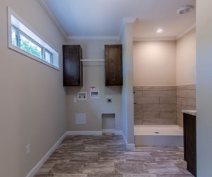 laundry room at the bailey house made by pratt homes tyler tx