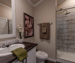 bathroom in house model cottage 16 2/1 made by pratt homes tyler texas