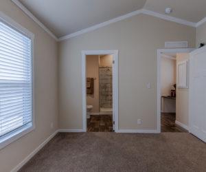 main bedroom in house model cottage 16 2/1 made by pratt homes tyler texas