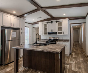 kitchen island at the frenchman house made by pratt homes tyler tx