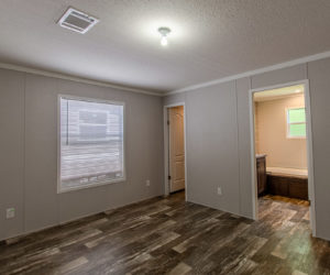 master bedroom at the frenchman house made by pratt homes tyler tx